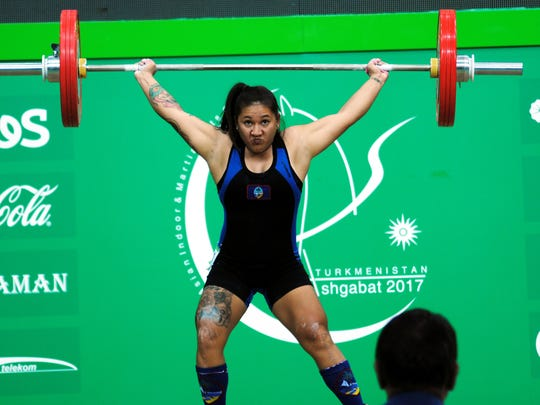 "Weightlifter Jacinta ""Ja"" Sumagaysay makes a successful"