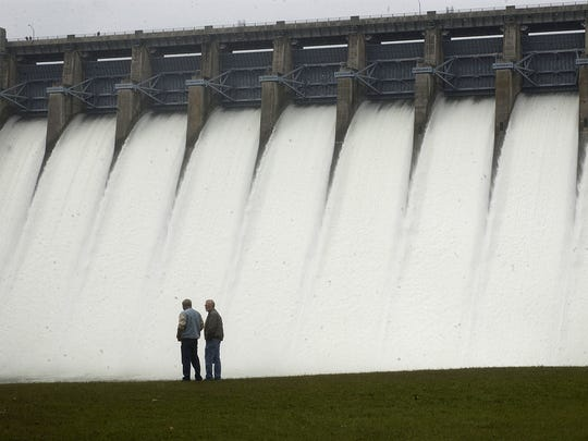 A file photo from 2009 shows water pouring through the spillway gates at Table Rock Lake dam.