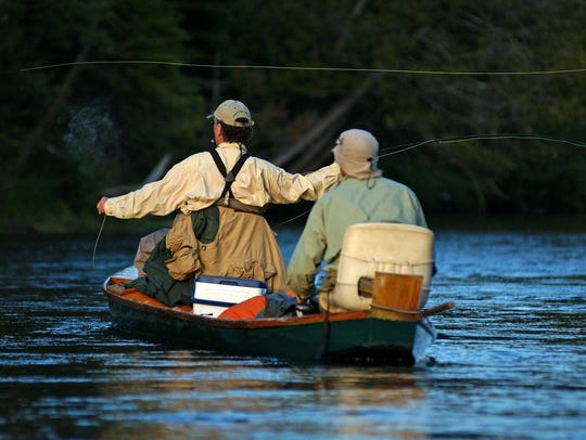 Fly fishing on the Au Sable is big business in the