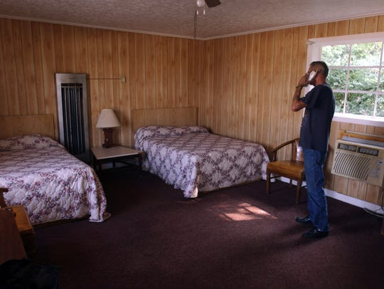 In this 2004 file photo, the manager of The Siesta Motel in Bossier City talks on the phone in room #14 where it is speculated that Elvis stayed when he was in town.