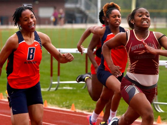 Blackman's Tanalya Gordon, left and Riverdale's Ar'Nazsia Johnson compete in the Girls 100 Meter Dash at the Rutherford County Girls Track and Field Championship at Stewarts Creek on Tuesday April 24, 2018.