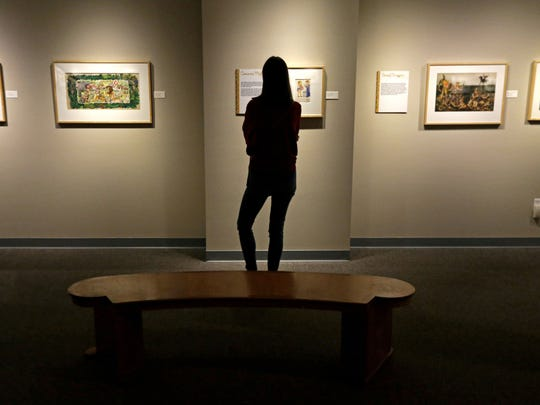 Polina Matveeva of Menasha visits the Trout Museum of Art Saturday as an exhibit showcasing the original art from 65 years of Golden Books opens at the downtown Appleton gallery. The exhibit runs through Nov. 5.