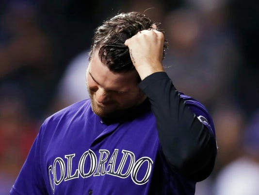 Colorado Rockies relief pitcher Adam Ottavino pulls his hair as he heads to the dugout after giving up five runs to the Los Angeles Dodgers in the ninth inning of the second baseball game of a doubleheader Wednesday, Aug. 31, 2016, in Denver. Los Angeles came from behind to win 10-8. (AP Photo/David Zalubowski)