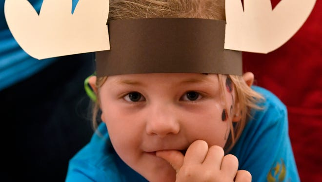 """Emma Adams, 6, of Abilene, wears the new """"moose antlers"""" she made Friday at the Center for Contemporary Arts during the Children's Art & Literacy Festival."""