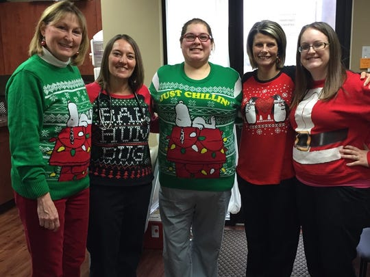 Ugly sweater lunch An ugly sweater holiday pitch-in lunch at Dr. John Reid's office brought out some of the season's least attractive but fun holiday attire. In the photo from left are Susan Reid, Jennifer Miles, Samantha Rodriguez, Stacy Summers and Katelyn Lehman.