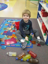 Justice plays with toys at Treffert Center.