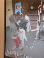 Surveillance footage of the two male suspects who robbed