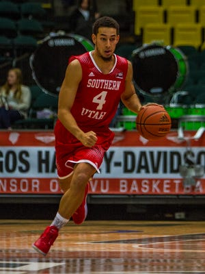 Southern Utah's Trey Kennedy (No. 4) dribbles the ball up the floor in the game at Utah Valley, Saturday, Dec. 5, 2015.