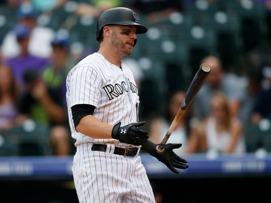 Colorado Rockies' Mark Reynolds reacts after striking out against Tampa Bay Rays relief pitcher Kevin Jepsen to end the bottom of the eighth inning of a baseball game Wednesday, July 20, 2016 in Denver. Tampa Bay won 11-3. (AP Photo/David Zalubowski)
