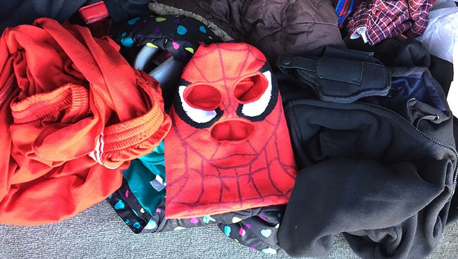 Spider-Man ski mask seen in the back of the suspects' vehicle