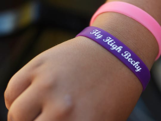 Noah Strausbaugh, 10, wears a bracelet dedicated to his mom, who was killed earlier this year.