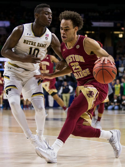 Boston College's Jordan Chatman (25) drives as Notre Dame's T.J. Gibbs (10) defends during the first half of an NCAA college basketball game Tuesday, Feb. 6, 2018, in South Bend, Ind. (AP Photo/Robert Franklin)