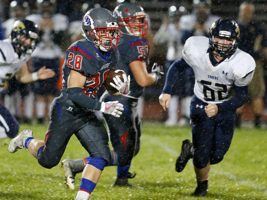 Owego's Dustin Dann runs with the ball during Friday's game versus Susquehanna Valley on September 29, 2017.