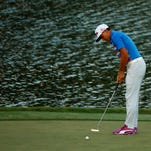 Rickie Fowler putts on the 17th green to win the final round of THE PLAYERS Championship during a playoff at the TPC Sawgrass Stadium course on Sunday in Ponte Vedra Beach, Florida.