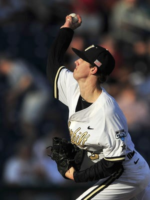 Vanderbilt pitcher Walker Buehler throws a pitch against Virginia during Game 3 of the national championship series.