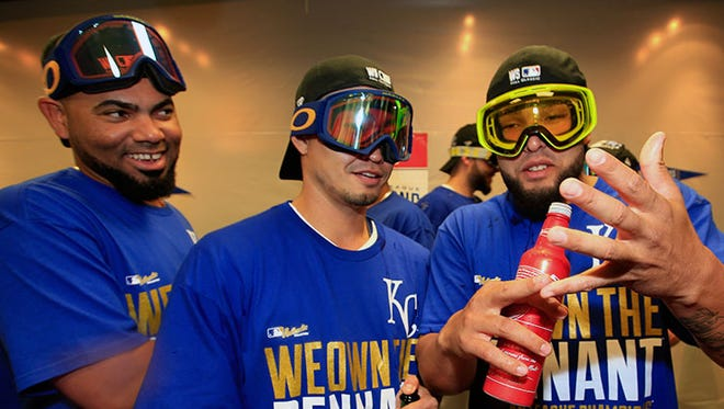 Royals outfielder Norichika Aoki, center, celebrates with teammates Kelvin Herrera, left, and Francisley Bueno in the locker room after their ALCS victory over Baltimore on Oct. 15 in Kansas City, Mo.