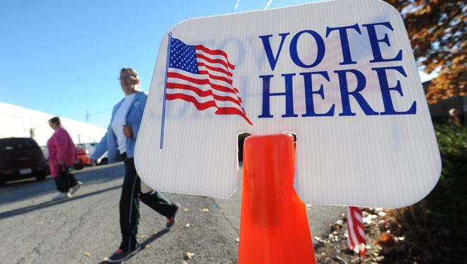 Voters leave the Youth Building at the Crawford County Fairgrounds after casting their ballots on election day.