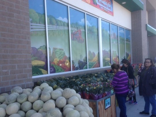 Shoppers looked at items outside the new Sprouts Farmers Market in East El Paso at the store's Wednesday opening.