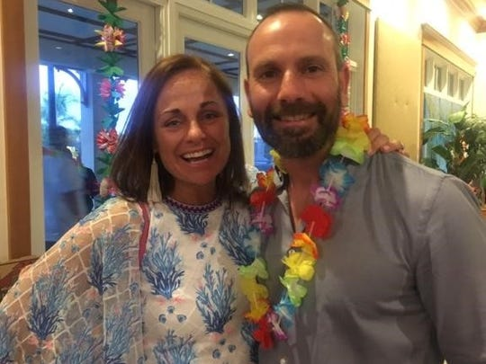 """Jennifer and Philip Nye share a smile at the """"Island Oasis"""" fundraiser for Beachland Elementary School on April 28."""