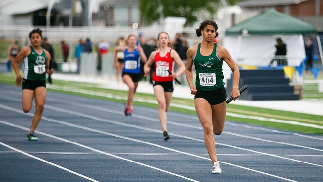 West Salem's Keira McCarrell crosses the finish line first in the 4x1 relay at the Greater Valley Conference district track and field meet on Friday, April 12, 2017, at West Albany High School