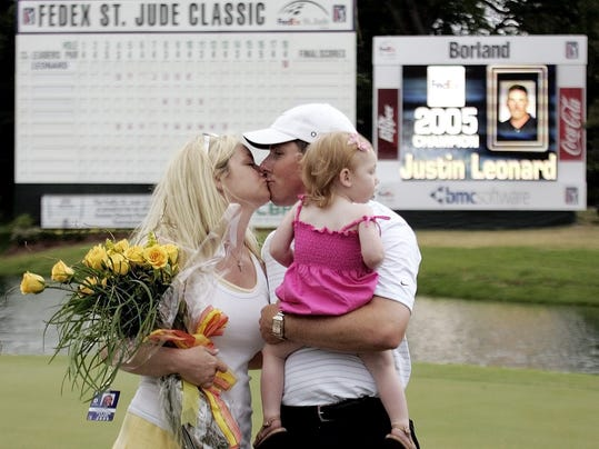 FILE - In this May 29, 2005, file photo, Justin Leonard gives his wife, Amanda, a kiss, as he hold his daughter, Reese, after winning the St. Jude Classic in Memphis, Tenn.  Over the years, Leonard and wife Amanda have quietly gone about their involvement in charity. They stumbled into Camp Mati without even looking, courtesy of a peculiar chain of events.  (AP Photo/Bill Haber, File)