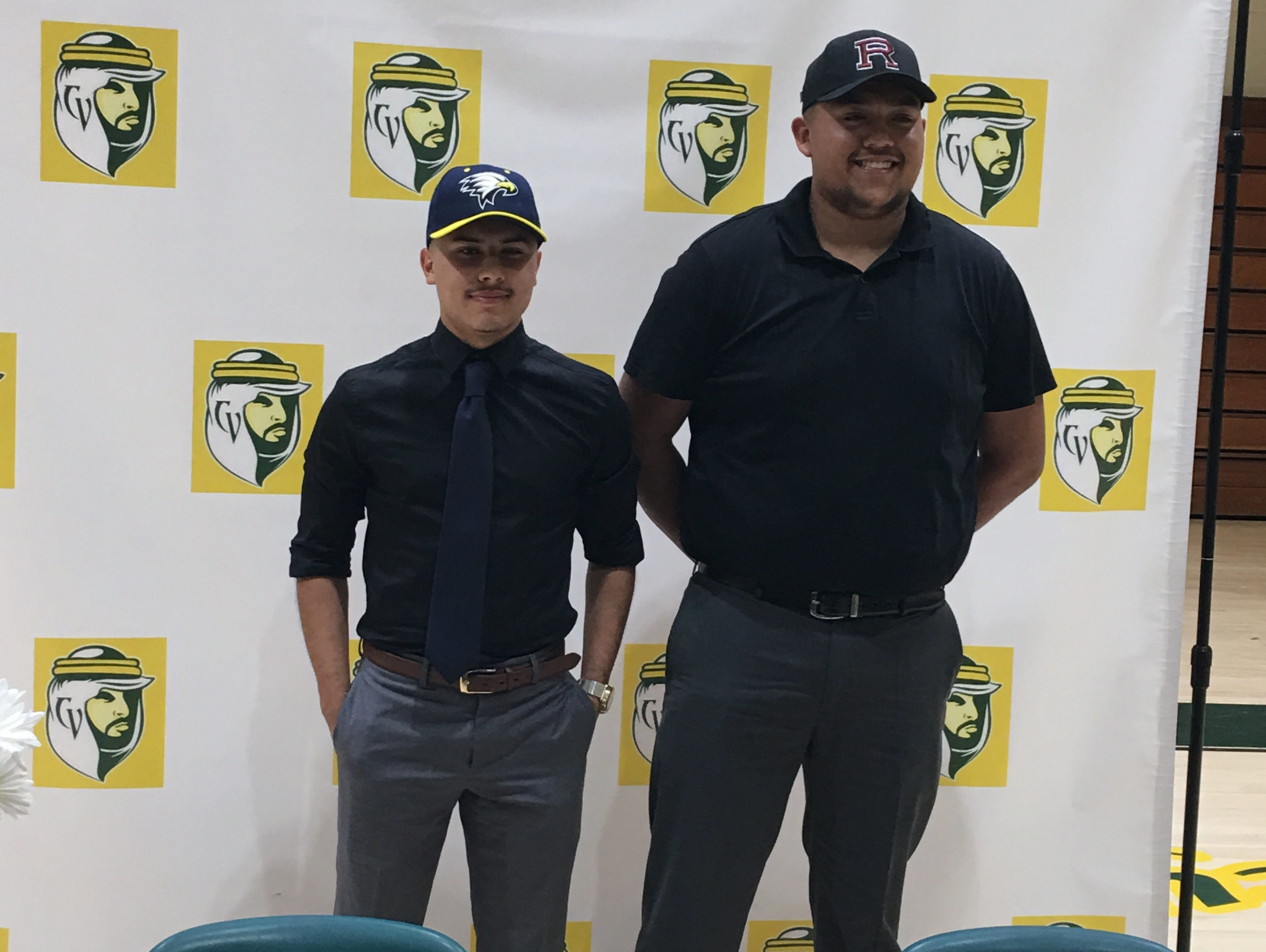 Coachella Valley seniors Wilfredo Ortiz and Nick Hernandez stand together with their team hats after signing their national letters of intent on Friday.
