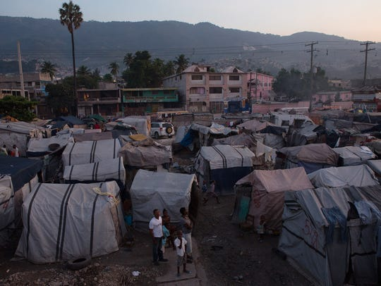 Many people continue to live in tent cities that sprung