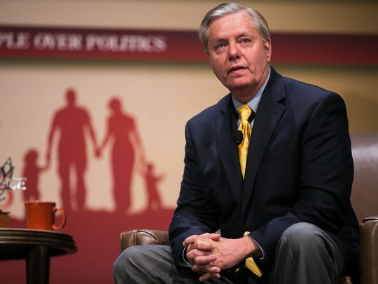 Senator Lindsey Graham tears up after answering a question about his parents who had passed away when he was 22 as he speaks with Frank Luntz during the Family Leadership Summit in Ames on Saturday, July 18, 2015.