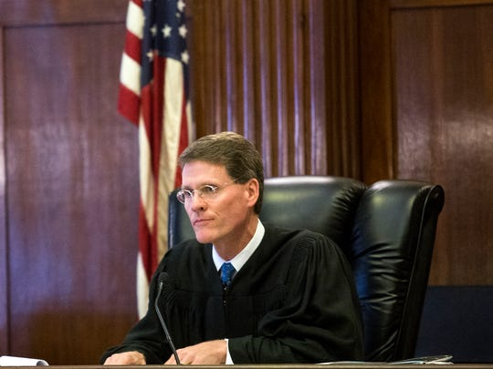 Judge Alan Thornburg listens to attorneys during an August 2015 hearing in Buncombe County Superior Court.