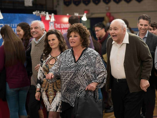 "Uncle Taki (Gerry Mendicno), Nikki (Gia Carides), Maria (Lainie Kazan) and Gus (Michael Constantine) roll through a lobby.  ""I thought, that everyone looked like four years not the real fifteen. It was bizarre,"" says John Corbett."