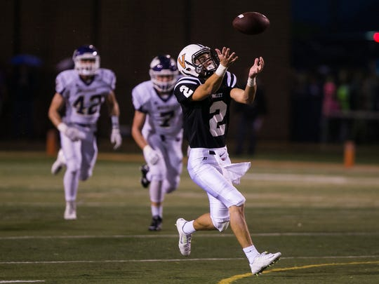 Valley's Austin Hinkle bobbles but catches a pass for a 78 yard touchdown to make the score 23-0 during their game against Waukee at Valley High School's football field in West Des Moines on Friday, August 28, 2015.
