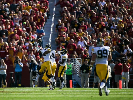 Iowa's Greg Mabin intercepts a pass during their game
