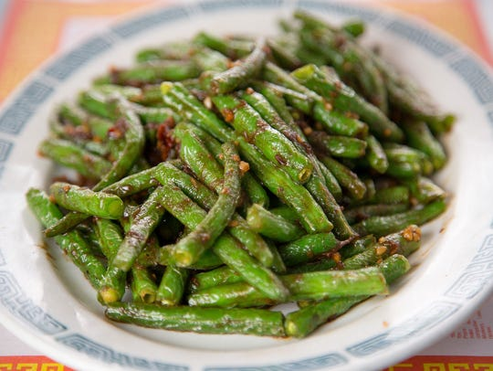 Green beans are stir fried with X.O. sauce, a Hong