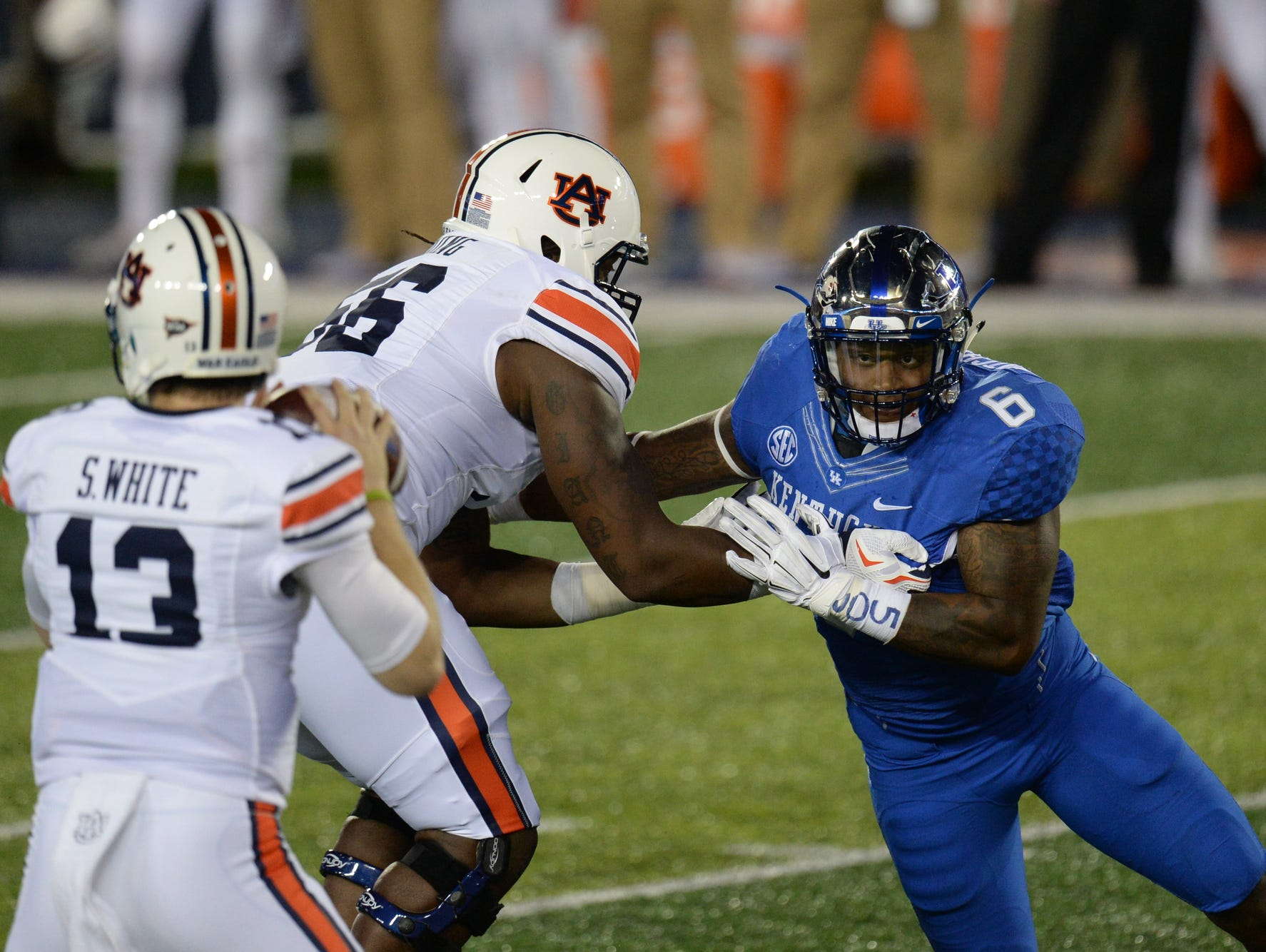 UK DE Jason Hatcher puts on the pressure during the first half of the University of Kentucky - Auburn football game at Commonwealth Stadium in Lexington, Ky., on Thursday, October 15, 2015.