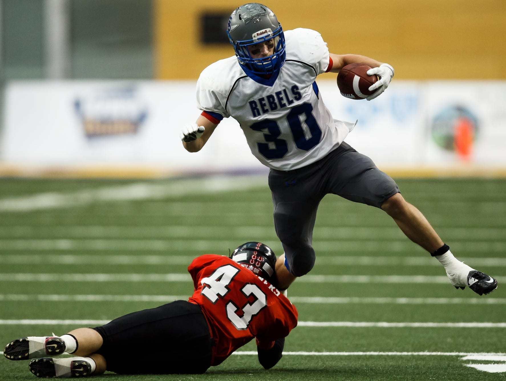 Gladbrook-Reinbeck's Eric Stoakes tries to break a tackle in the Class A state championship. Stoakes rushed for a record 282 yards.