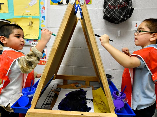Pre-K students Kevin Herrera, 4,  left, and Jose Vega-Estronza, 5, right, paint during their afternoon work time at Hannah Penn K-8 School in York, Pa. on Tuesday, Dec. 8, 2015. (Dawn J. Sagert - The York Dispatch)