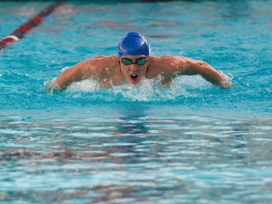 Desert Christian Academy junior Conor Murray swims the 100 m butterfly during a swim meet at La Quinta High School on Tuesday, March 15, 2016. Murray, who competes as an individual and is one of DCA's two swim team members, recorded a time of 1:08:19.