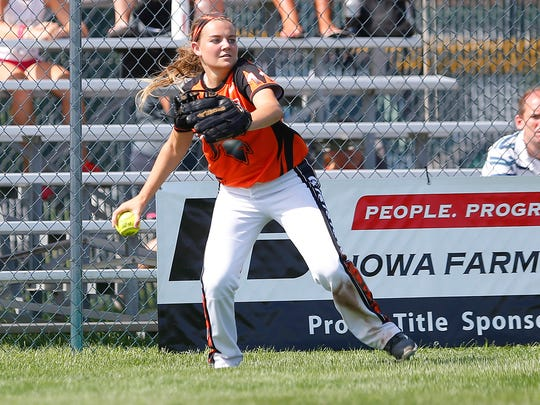 Solon's Bryn Hanrahan throws a ball in from the outfield against CMB in the 3A quarterfinals during the IGHSAU State Softball Tournament in Fort Dodge, Wednesday, July 20, 2016.