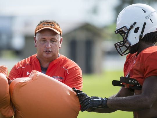 Palmyra head coach Chris Pope leads a drill during preseason practice..