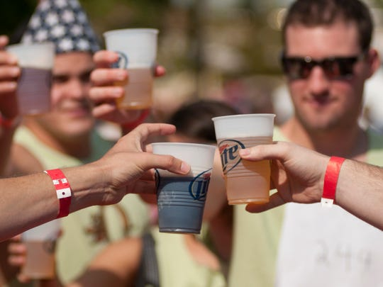 Contestants toast each other before the start of the Beer Games at GermanFest at the Athenaeum in Indianapolis, Saturday, Oct. 12, 2013.