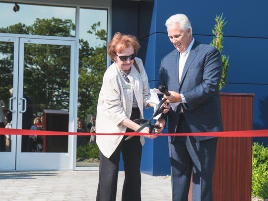 Martin Insurance Group (MIG), a family owned, privately held independent insurance agency, recently conducted a grand opening to mark the opening of new offices in Cranbury. Cutting the ribbon are is Councilwoman Elizabeth Schneider, left, and company founder Tracy Martin.
