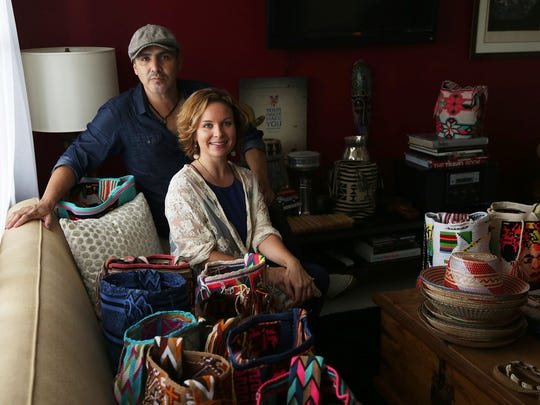 Thea Mason and Diego Verney with the handmade bags that they sell through their company Lula to support the Wayuu tribe artists in Colombia. They are pictured in their Naples home on Wednesday, Sept. 14, 2016.