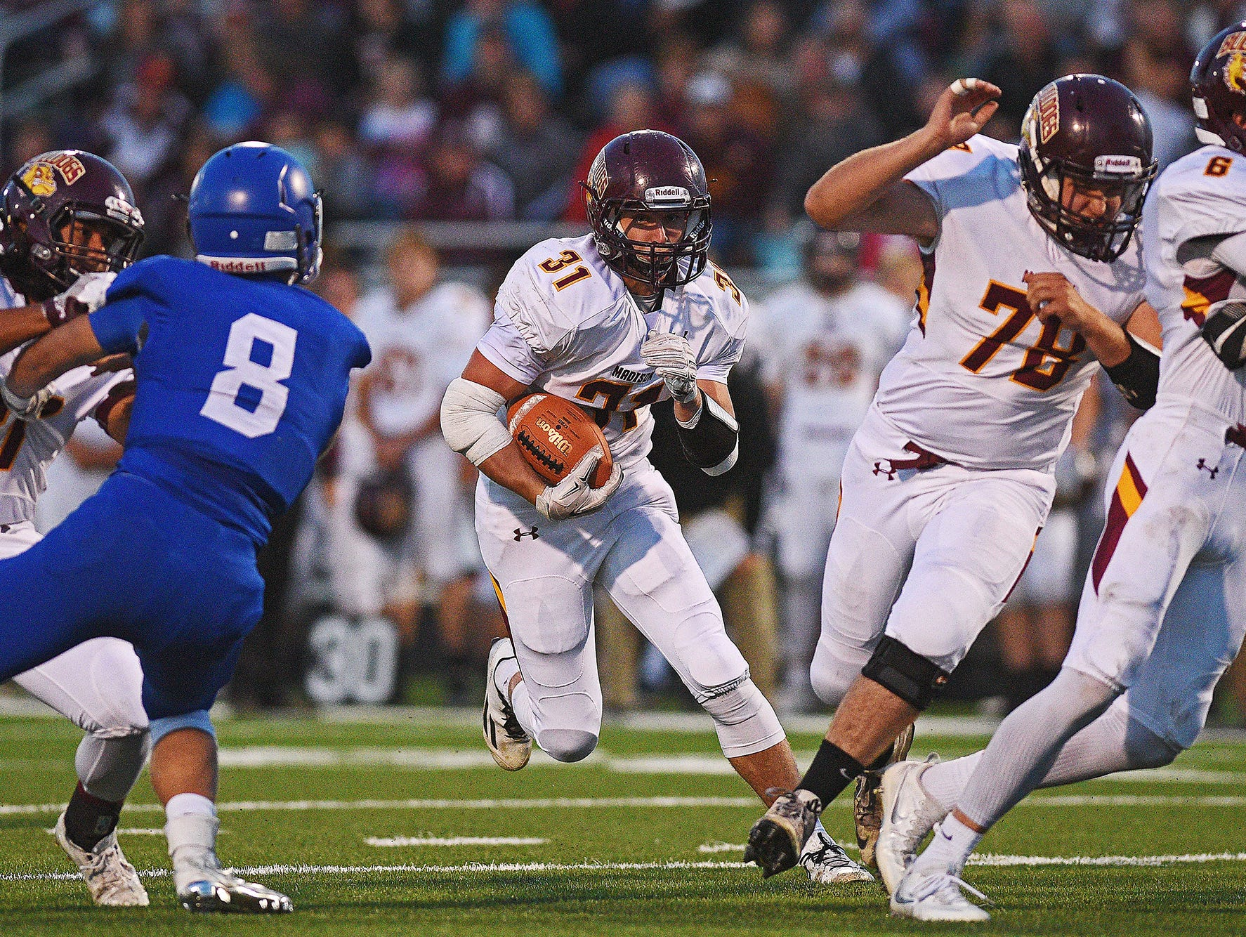Madison's Riley Janke (31) rushes with the ball during a game against Sioux Falls Christian Friday, Sept. 30, 2016, at Bob Young Field in Sioux Falls.