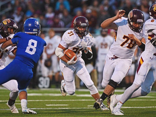 Madison's Riley Janke (31) rushes with the ball during