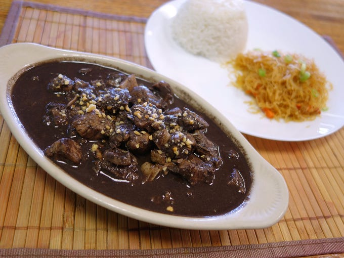 Dinuguan is a vinegary Filipino stew fortified with