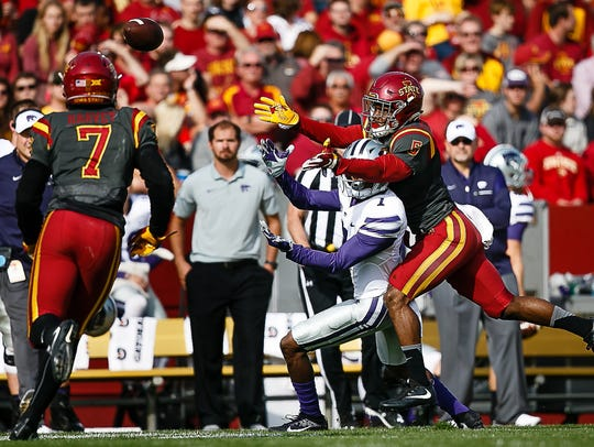 Iowa State's Kamari Cotton-Moya breaks up a pass intended