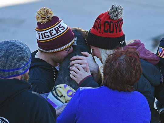 The third dog rescued by Sioux Falls Fire Rescue at the site of the Copper Lounge building collapse is reunited with the Fodness family and friends Sunday, Dec. 4, 2016, in downtown Sioux Falls more than 48 hours after the collapse. One person was killed and Emily Fodness was injured in the collapse. Two other dogs were also rescued from the scene.