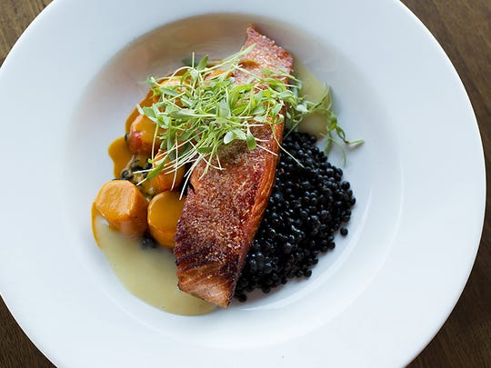 The organic Scottish salmon with baby black lentils,
