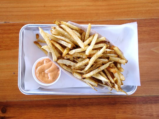 Hand cut fries with Stand sauce at The Stand Burgers