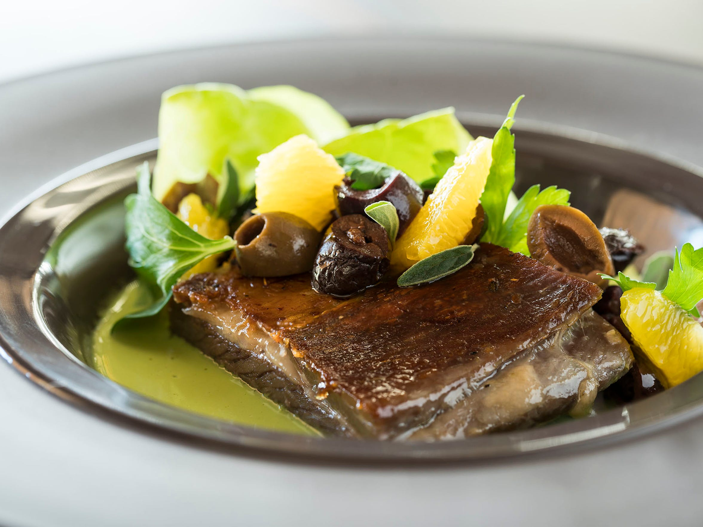 Braised lamb belly with citrus-olive salad at Weft